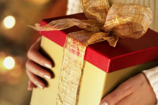 festive Christmas present --- Image by © Royalty-Free/Corbis